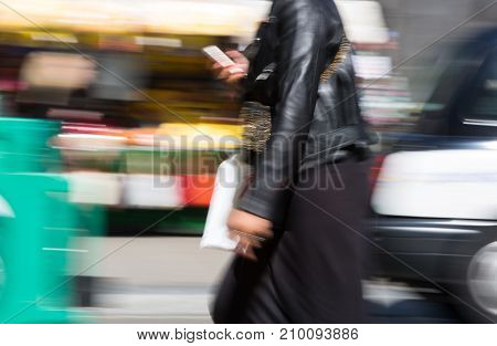 LONDON, UK - June 9, 2017: Blurred image of walking people at Oxford street, the main destination for shopping at Westend.