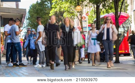 LONDON, UK - June 9, 2017: Blurred image group of walking people at Oxford street, the main destination for shopping at Westend.