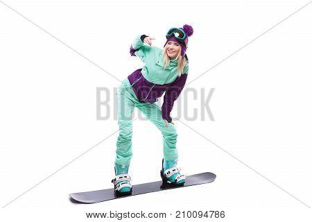 Young Pretty Woman In Purple Ski Costume Ride Snowboard