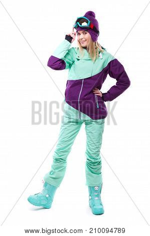 Young Beautiful Woman In Purple Ski Suit And Blue Snow Boots