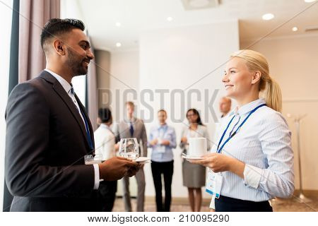 business and education concept - group of people at international conference coffee break