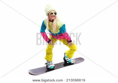 Beauty Young Woman In Ski Suit And Sunglasses Ride Snowboard