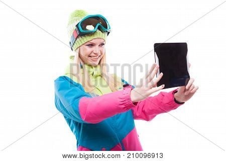 Pretty Young Woman In Ski Outfit And Ski Glasses Hold Tablet