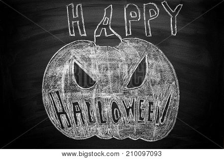 Hand Drawn Jack O Lantern Chalk Illustration on Blackboard. Happy Halloween Lettering Text. Greeting Card Party Poster Invitaiton Template. Spooky Face Expression