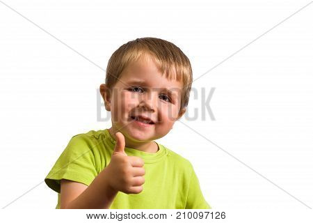 Happy little boy (4 year old) giving a thumbs up. Isolated on white background