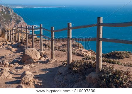 View od Cabo da Roca in Sintra - Roca Cape - cliffs and fence at sunset.