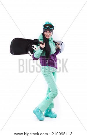 Young Pretty Woman In Purple Ski Costume And Ski Glasses Hold Snowboard