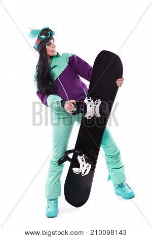 Young Pretty Woman In Purple Ski Costume Hold Snowboard