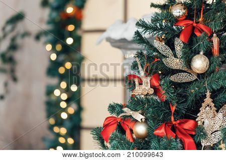 Christmas toy train and garland on the fir tree. vintage color