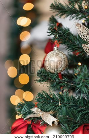 Christmas ball and garland on the fir tree. vertical photo