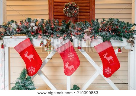 Christmas sock and decoration on wood. three socks for gifts