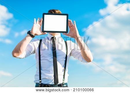 Attractive Busunessman In White Shirt, Tie, Braces And Sunglasses Shows Empty Tablet