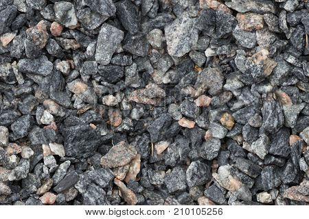 Seamless texture of close up granite breakstone gravel. Crushed stone background for design usage.