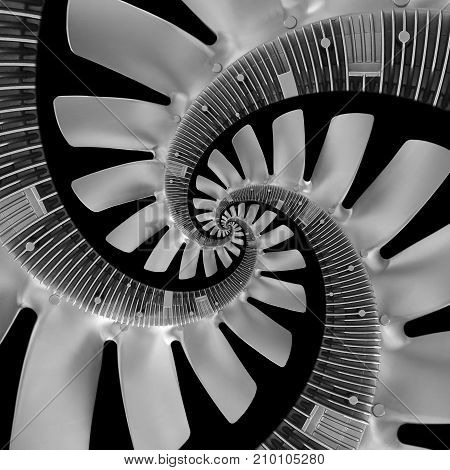 Isolated on white abstract spiral fractal made of truck engine silver air screw. Spiral background pattern. Automotive parts details pattern background. Spiral fractal effect. Truck diesel engine fan