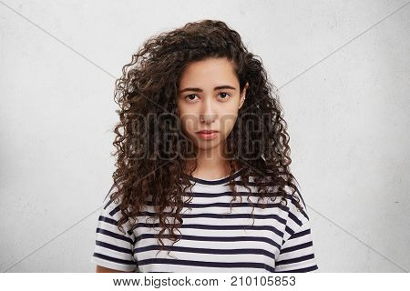 Upset Female Has Crisp Hair, Sullen Or Gloomy Expression, Being Displeased With Results Of Her Proje
