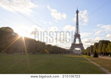 Eiffel Tower And The Sun With Its Rays In Paris, France