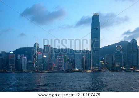 HONG KONG - OCTOBER 2: Sunset over Victoria harbor on October 2, 2017 in Hong Kong, China. Victoria Harbour is a natural landform harbour situated between Hong Kong Island and Kowloon in Hong Kong.