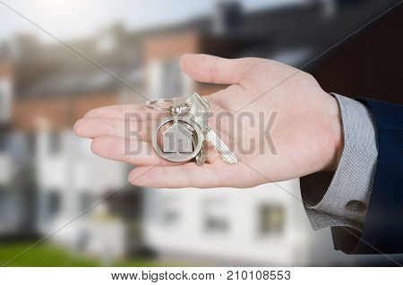 Real Estate Agent With Home Keys