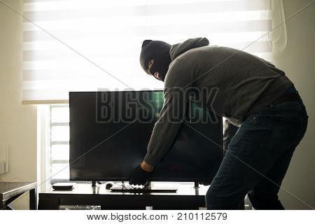Man Stealing Tv In A House