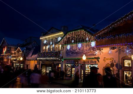 LEAVENWORTH, WA/USA - DECEMBER 21, 2013: This  editorial a Bavarian store lit up with Christmas lights at night with shoppers.