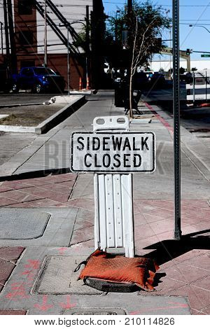 Sidewalk closed sign board closing a sidewalk
