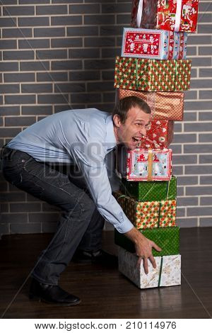 The man screams from the tension. Preparation of gifts for the new year.