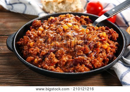Chili con carne in frying pan on table