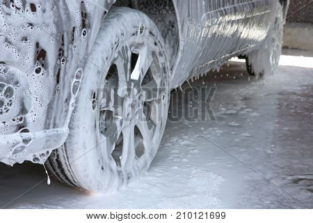 Automobile in suds at car wash, closeup