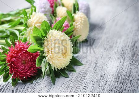 Bouquet of chrysanthemum flowers on wooden table, closeup