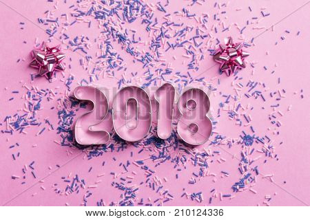 New Year 2018 numbers on the pink background