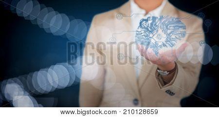 Businesswoman using digital screen against white background against defocused image of illuminated lights
