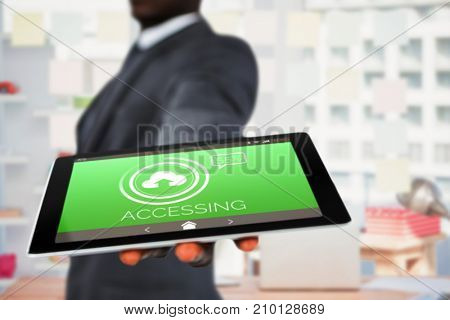 Midsection of businessman holding digital tablet against uploading symbol with text on green screen