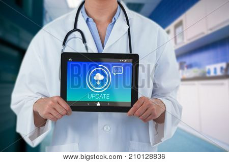 Midsection of female doctor holding digital tablet against update text with download symbol on screen