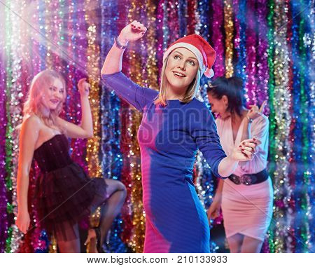 Group of happy cheerful girls celebrating new year party