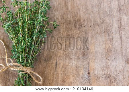 Thyme Bunch. Bundle Of Fresh Thymes On A Wooden Background