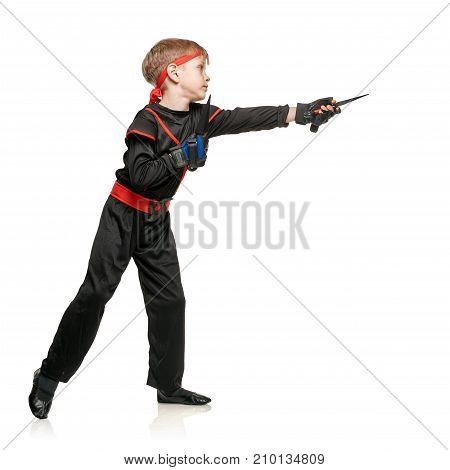 Little sporty boy doing wushu on white background. Cosplay hero ninja