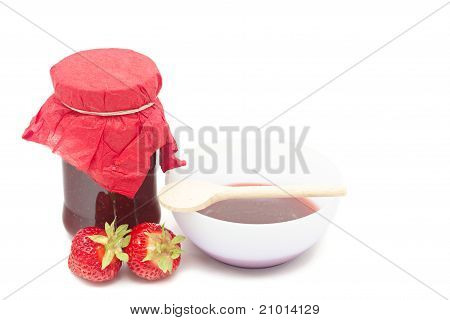 Glass pot with strawberry jam isolated on white poster