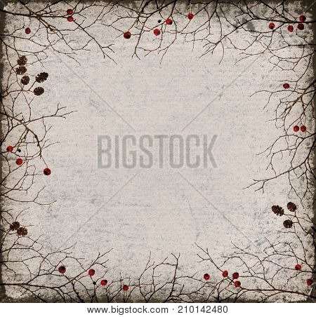 Dry twigs frame with cones and berries on old paper background. Autumn grunge concept.