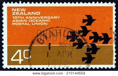 NEW ZEALAND - CIRCA 1972: A stamp printed in New Zealand issued for the 10th anniversary of Asian-Oceanic Postal Union shows Postal Union symbol, circa 1972.