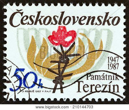 CZECHOSLOVAKIA - CIRCA 1987: A stamp printed in Czechoslovakia issued for the 40th anniversary of Terezin Memorial shows Barbed Wire, Flames and Menorah, circa 1987.