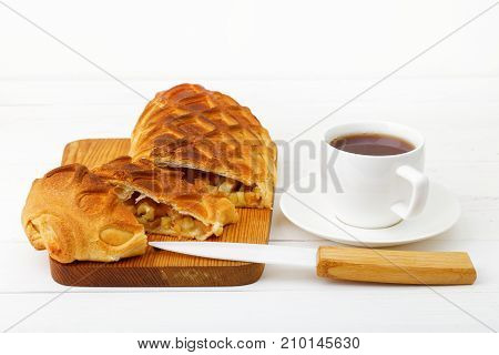 Strudel With Apples And Cinnamon On White Wooden Table.