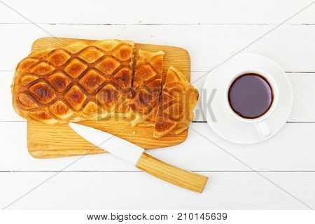 Strudel With Apples And Cinnamon On White Wooden Table