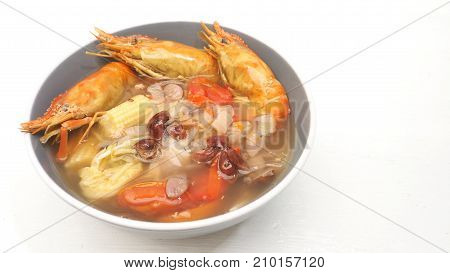 Suki Giant malaysian prawn diet for health menu idea on white wood has copy space The ingredients are red grapes onion tomato baby Corn Chinese cabbage Enoki Mushroom.