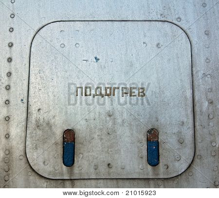 Old metal cover of airplane compartment