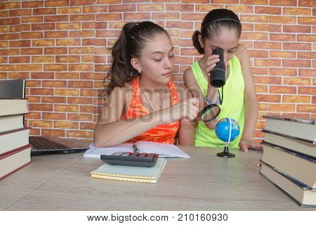 Two Young Girl studying on desk at home. Thoughts education creativity concept