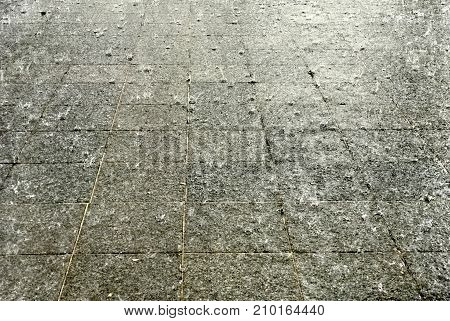 Tropical pouring rain on pavement ground closeup in Singapore for background