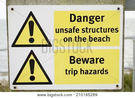 A ganger for unsafe structure on the beach UK.