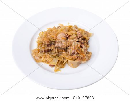 Closeup of chicken and cabbage stir-fry on a plate. Isolated on a white background.