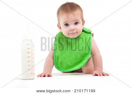 Cute Happy Little Boy In Green Bib Near Milk Bottle