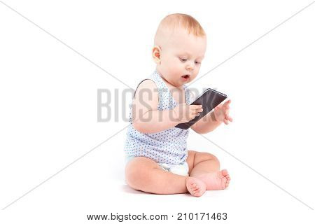 Cute Joyful Baby Boy In Blue Shirt And Diaper Hold Cellphone